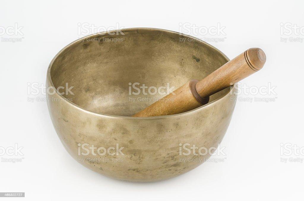 Singing Bowl with Ringing Stick. stock photo