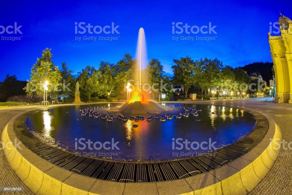 Singing fountain at night - spa resort Marianske Lazne (Marienbad) stock photo