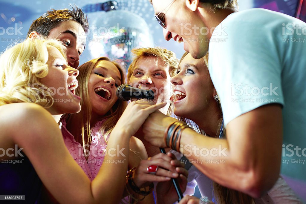 Singing friends stock photo