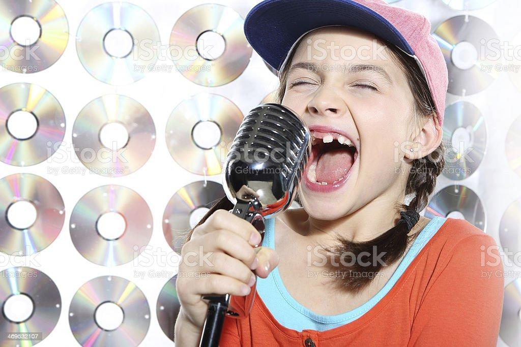 Singing girl in the orange cap stock photo