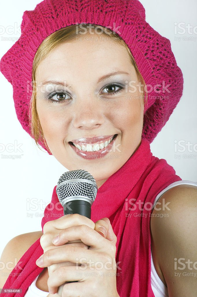 singing happy woman with a microphone royalty-free stock photo