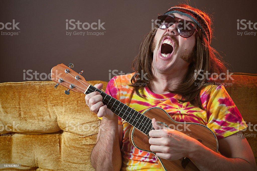 Singing Hippy Man with Ukelele stock photo