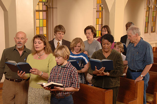 Singing Hymns in Church  pew stock pictures, royalty-free photos & images