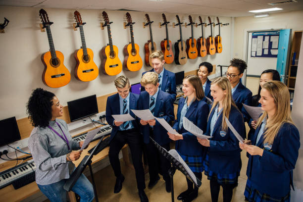 singing in music lesson - private school stock photos and pictures