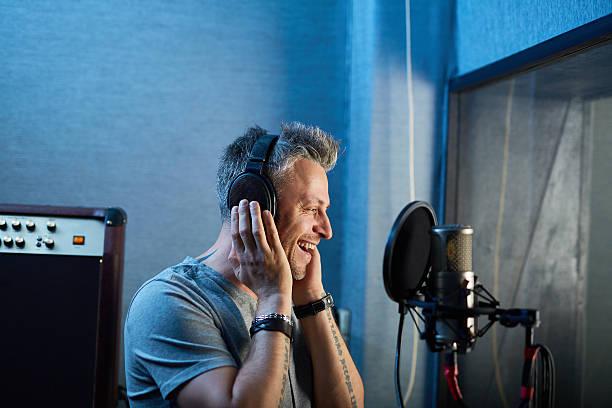 singing in studio - radio dj stock photos and pictures