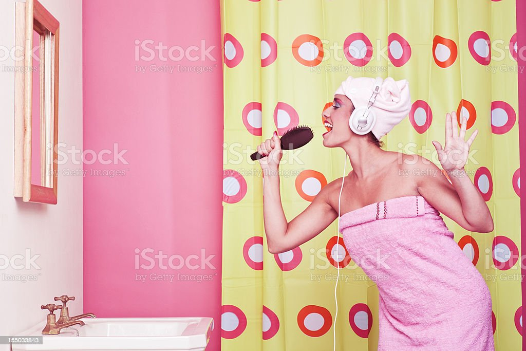 Singing in the bathroom with a hair brush_ humor stock photo