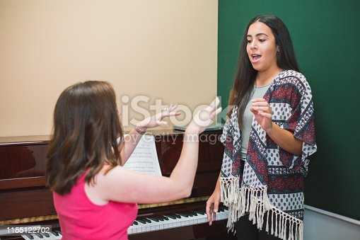 istock Singing Lessons 1155122702