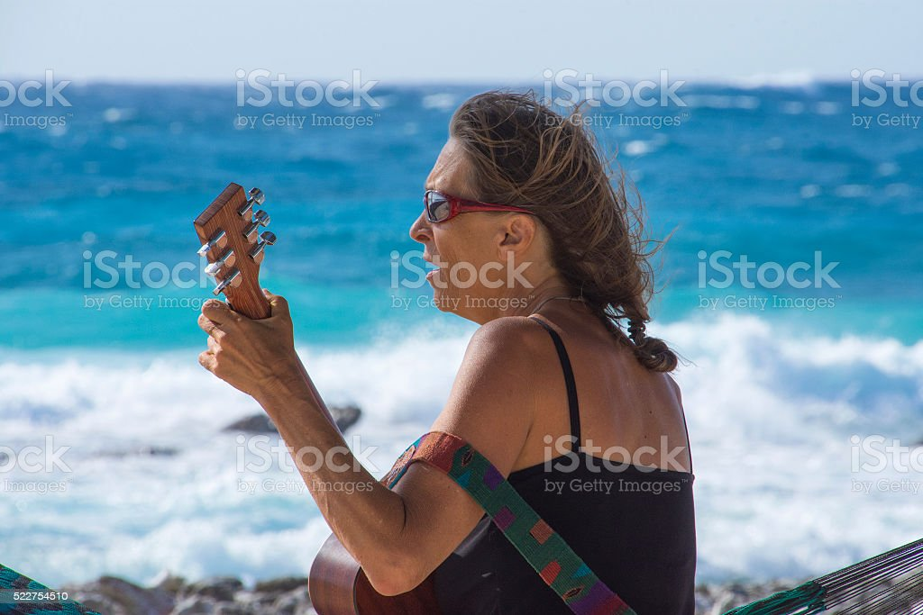 Singing to the sea stock photo