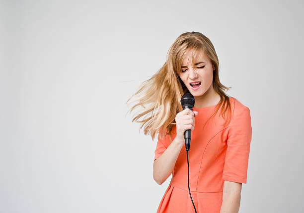 Singing young woman stock photo