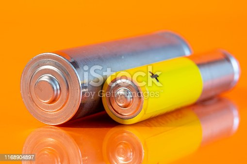 istock Single AA and single AAA battery 1168904897