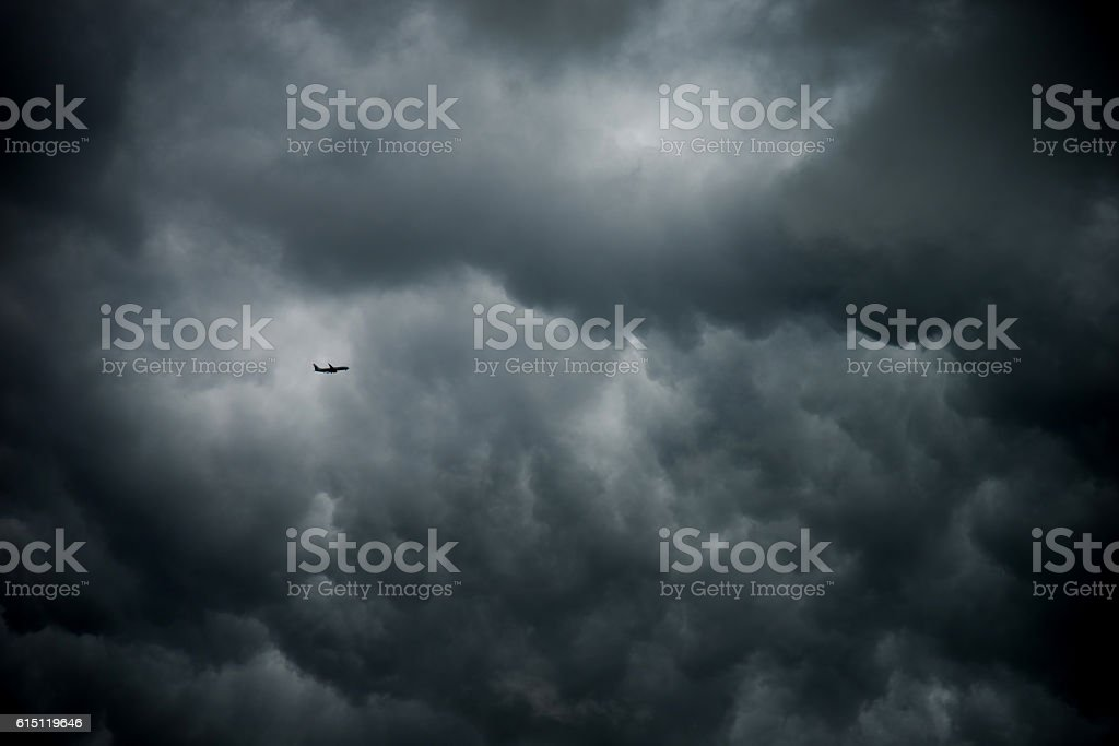 Single airplane in a stormy sky stock photo