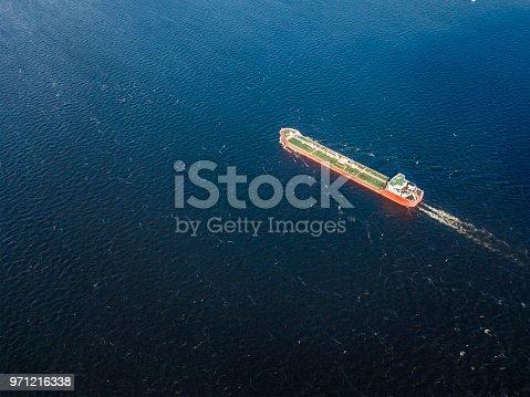 istock single alone cargo barge in the sea 971216338