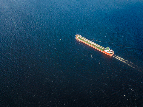 istock single alone cargo barge in the sea 971216338