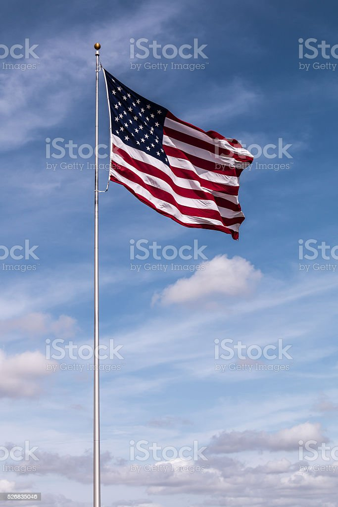 Single American Flag with Cloudy Sky stock photo