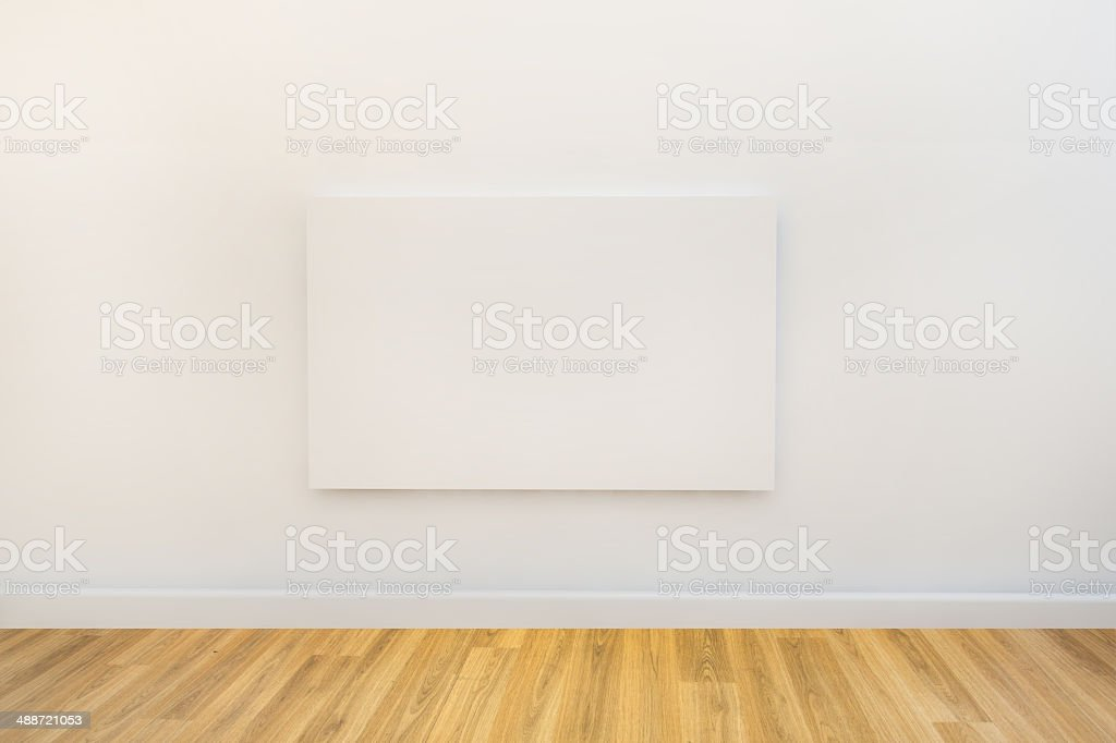 single art canvas in an empty gallery space stock photo
