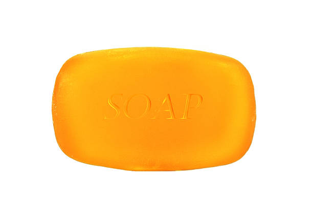 A single bar of orange soap on a white background stock photo