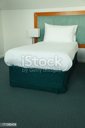 Single bed in a hotel room