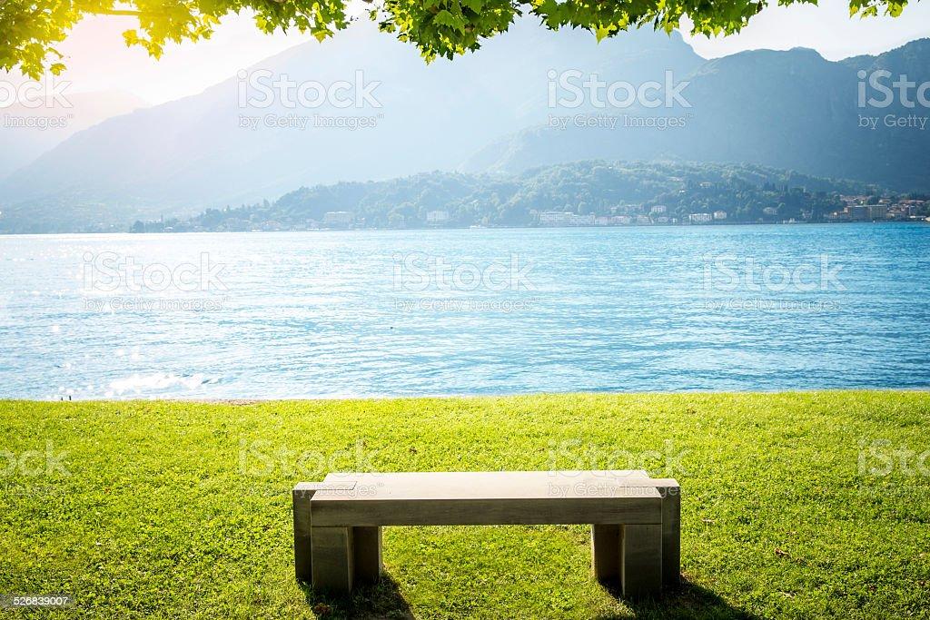 Single bench at Como lake stock photo