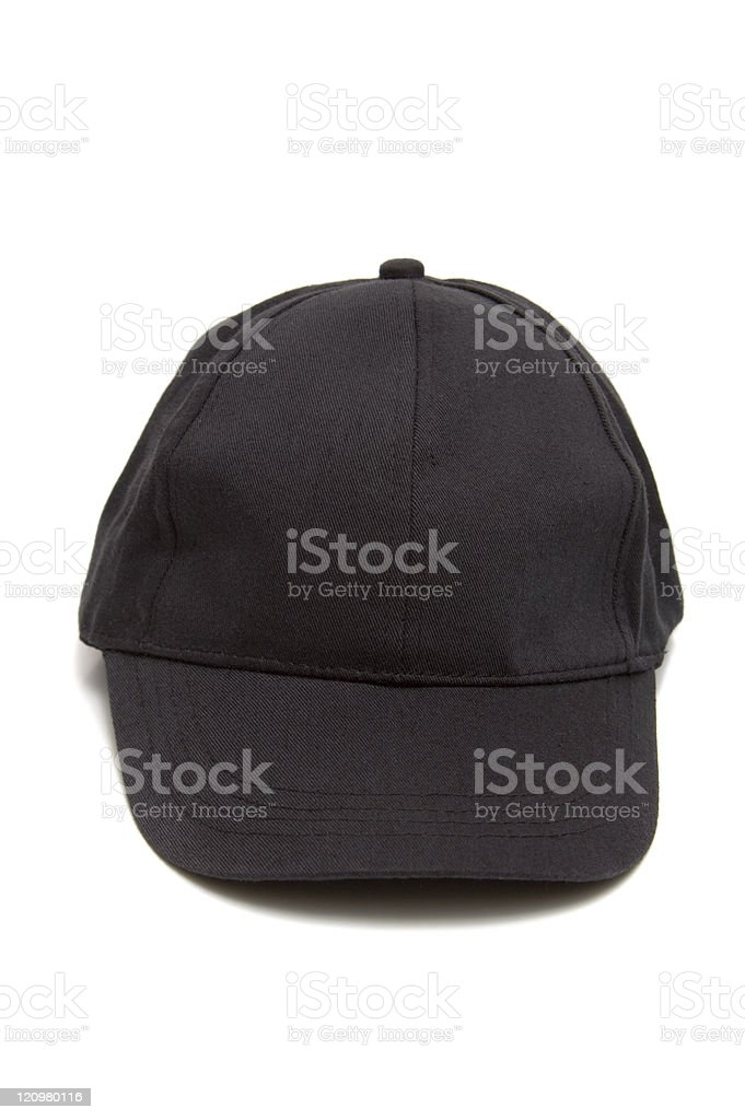 A single black baseball cap on a white background royalty-free stock photo