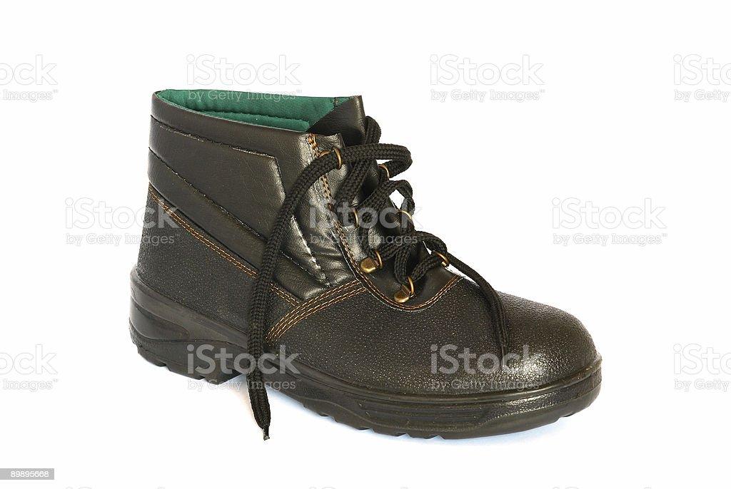 Single black boot isolated on white. royalty-free stock photo