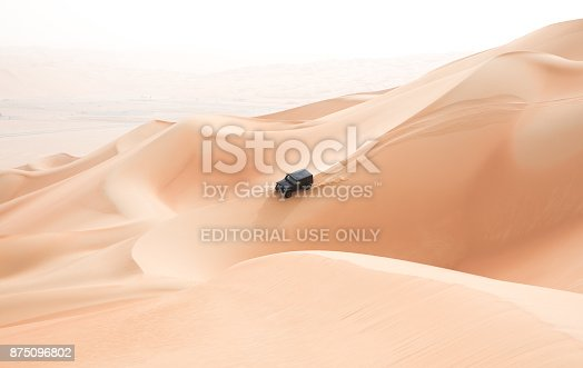 istock A single black car scaling giant dunes in the Empty Quarter desert. 875096802