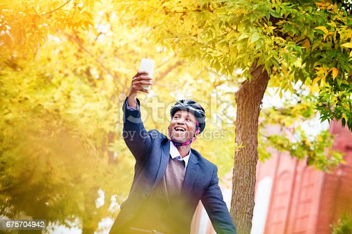 istock Single black male in his 30s taking a selfie while riding his bicycle 675704942