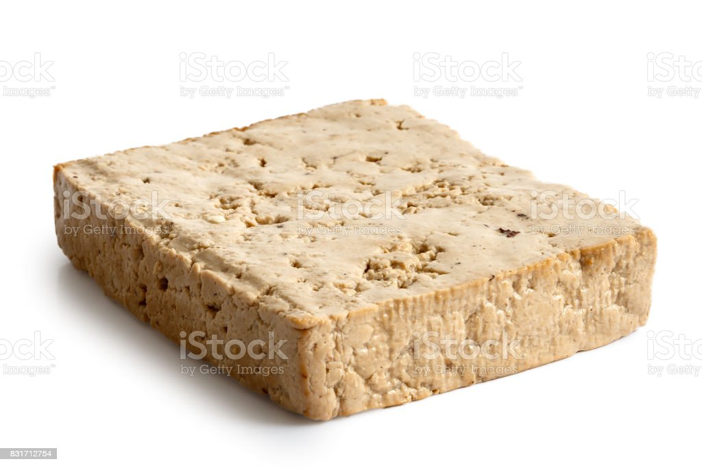 Single block of lightly smoked tofu isolated on white. stock photo