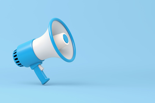 istock Single blue and white electric megaphone with a handle stands on a blue background 1189901322