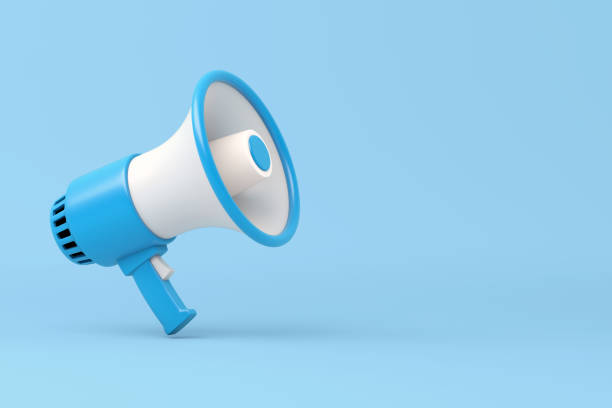 single blue and white electric megaphone with a handle stands on a blue background - megafono foto e immagini stock
