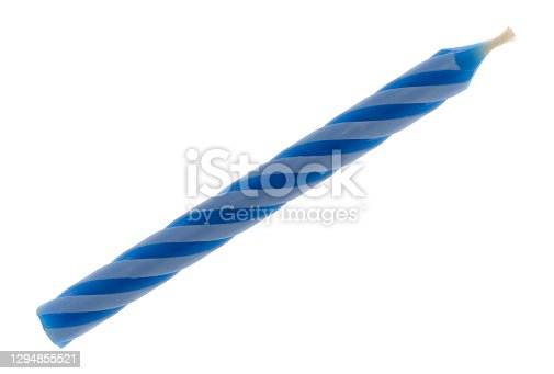 Single blue spiral birthday candle isolated on a white background.