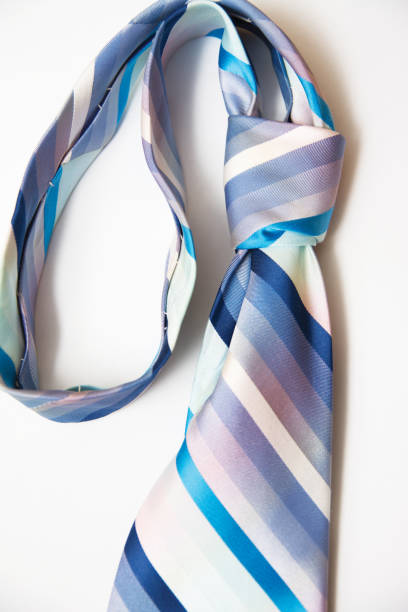 Single blue striped Necktie on White stock photo
