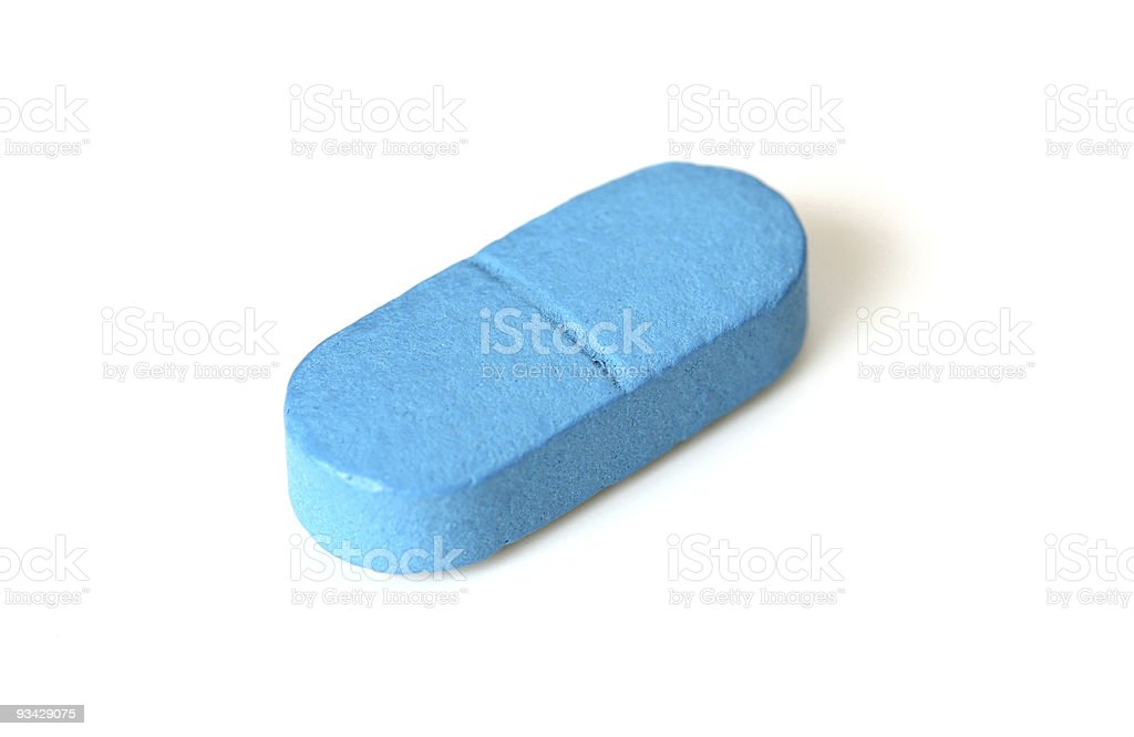 Single blue tablet or pill stock photo