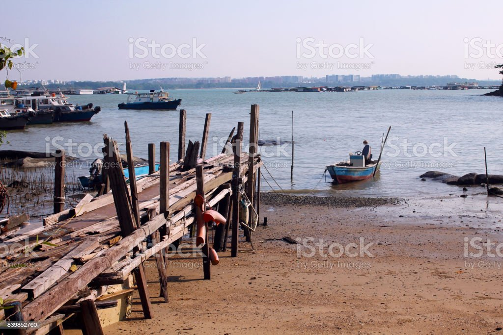 Single boat and jetty in Pulau Ubin, Singapore stock photo
