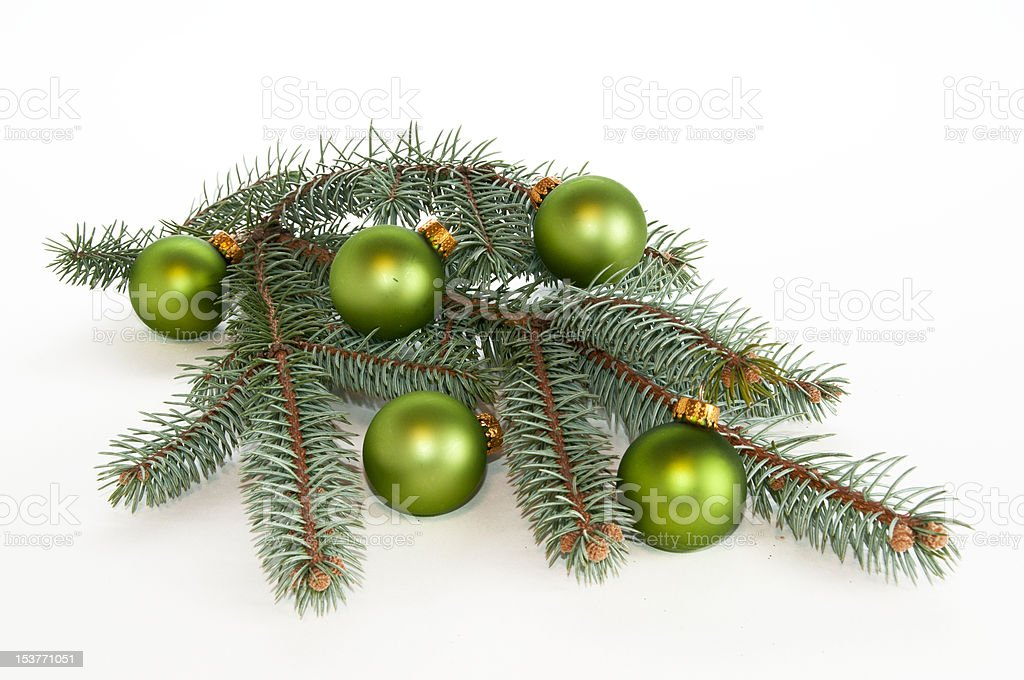 Single branch of evergreen decorated with green ornaments stock photo