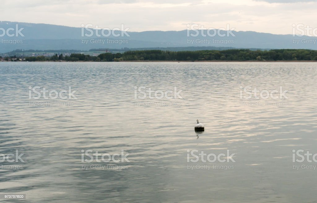 single buoy on a lake in the Swiss Alps in the evening stock photo