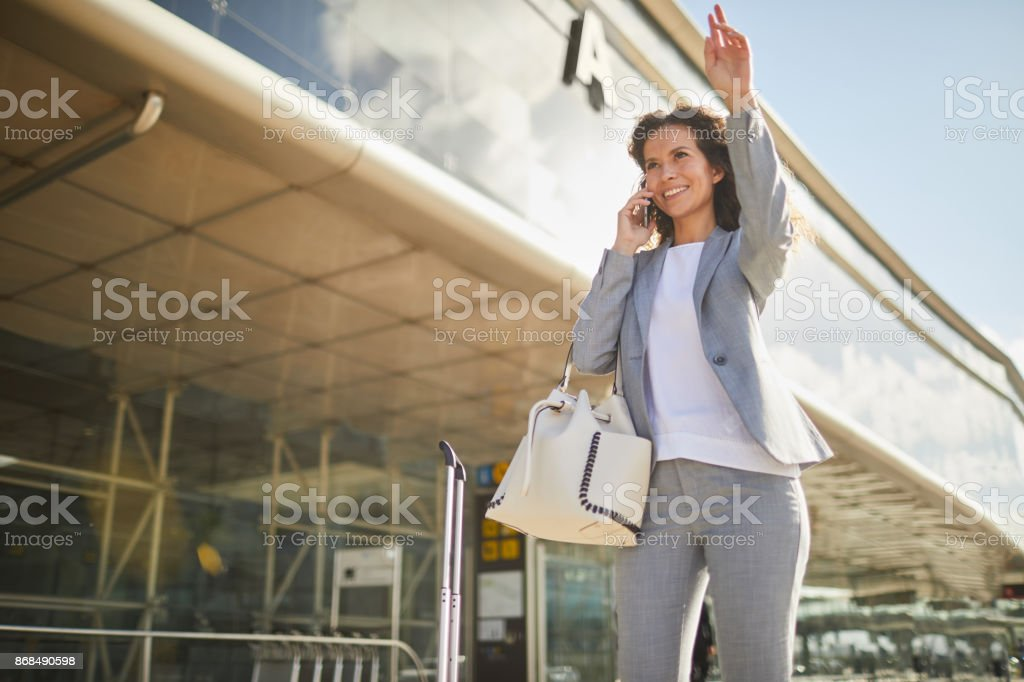 Single business woman commuting, on the move. stock photo
