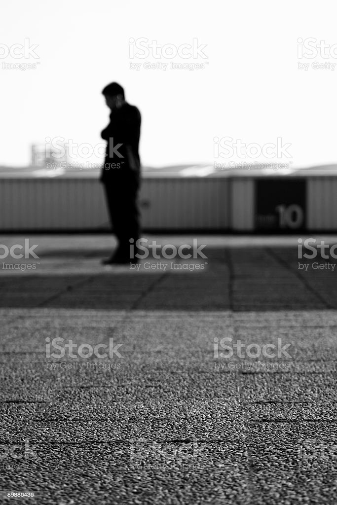 single businessman on roof royalty-free stock photo
