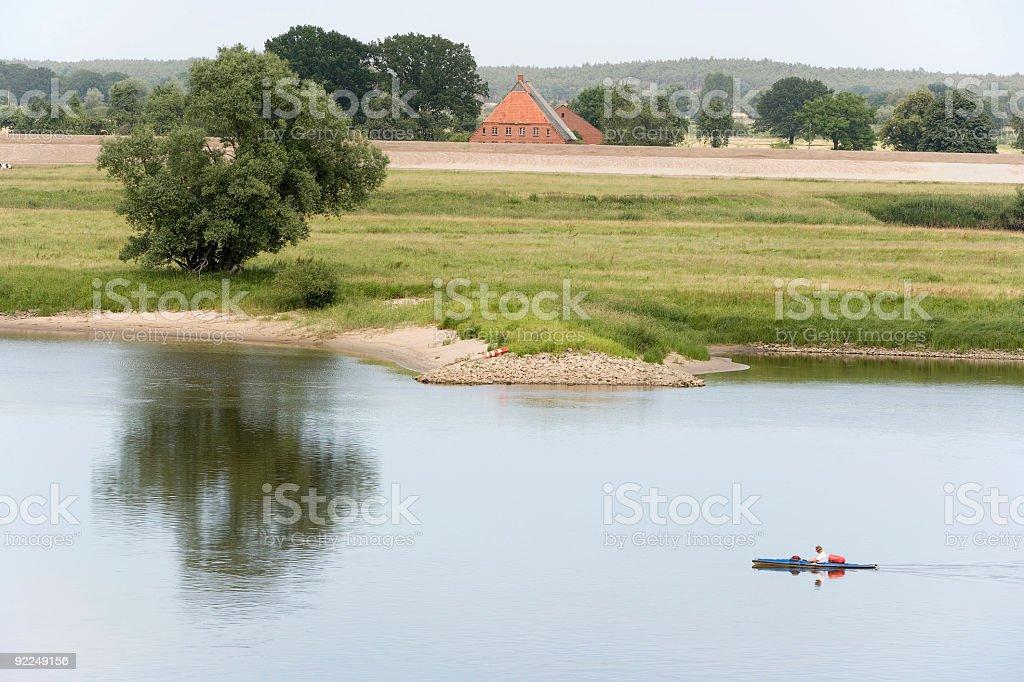 Single canoeist on River Elbe (XXL) royalty-free stock photo