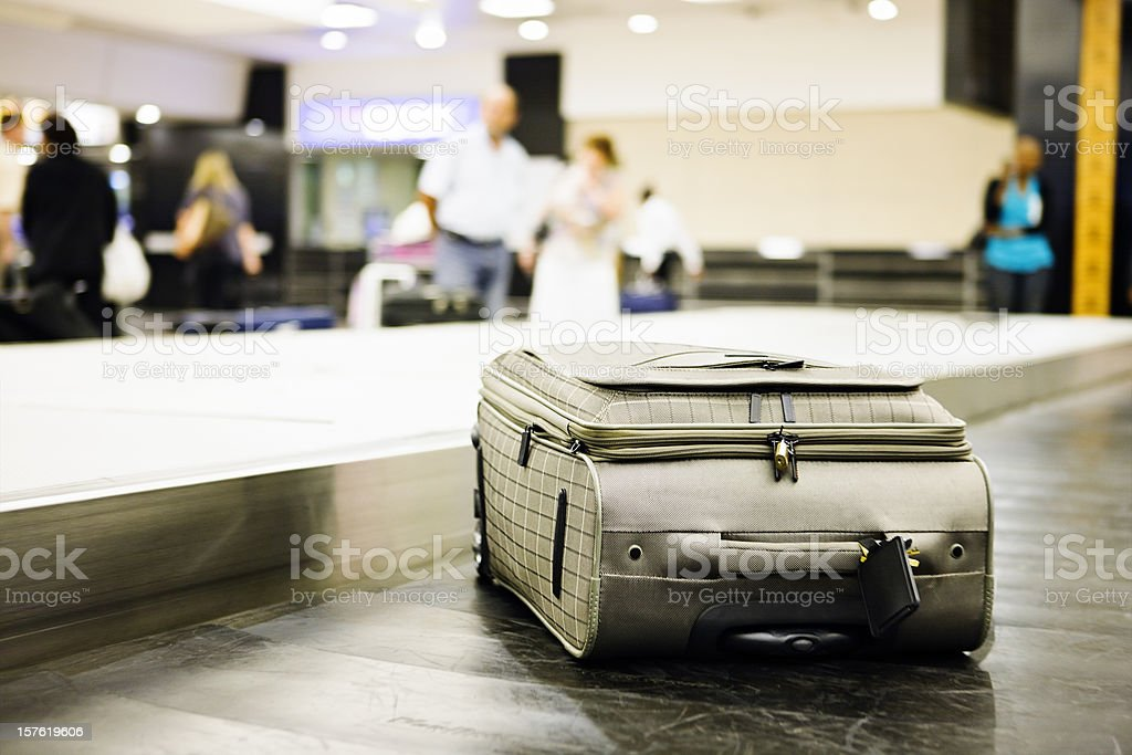 Single case on airport luggage carousel royalty-free stock photo