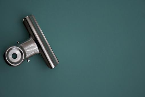 A single clip foldback on a green background