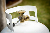istock Single close up of a propane take in a backyard 1216999198
