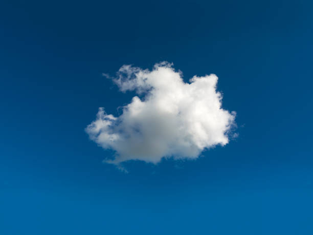 Single cloud central in blue sky stock photo