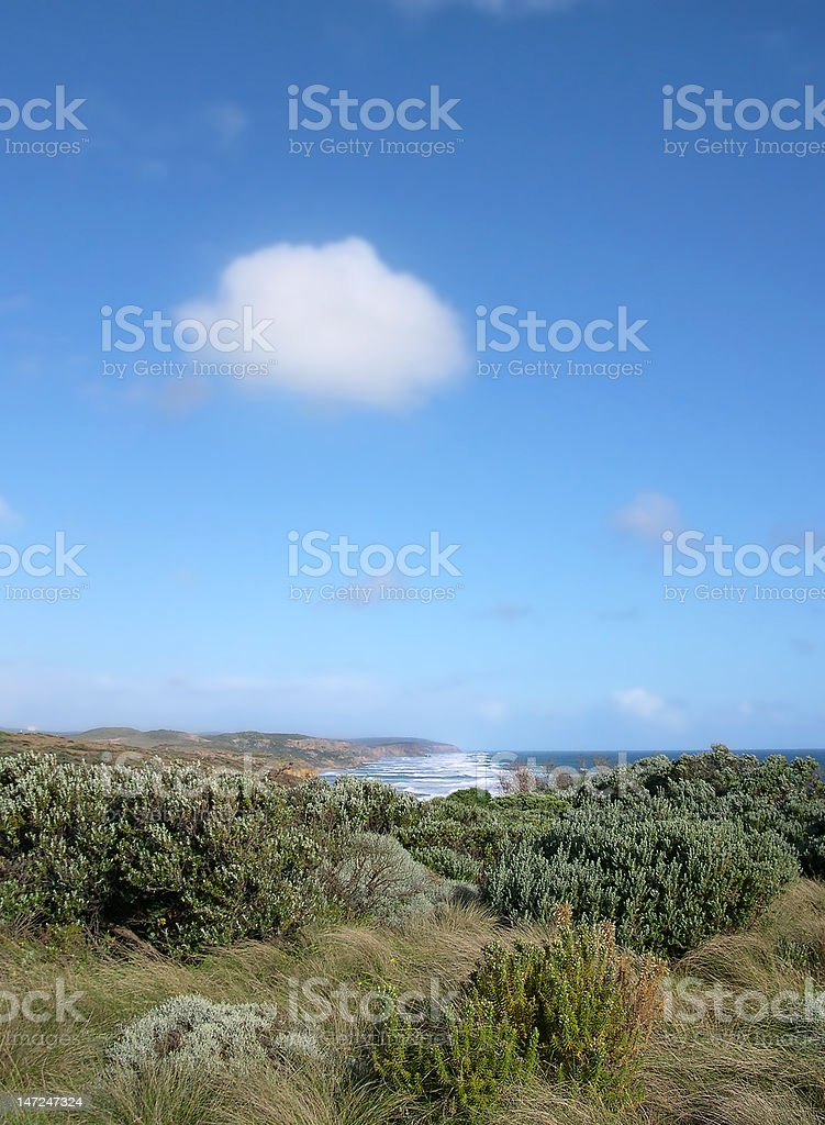 Single Cloud Floating Out To Sea stock photo