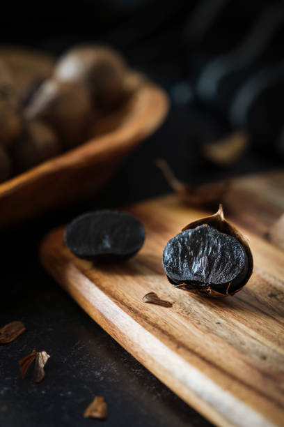 Single Clove Black Garlic stock photo