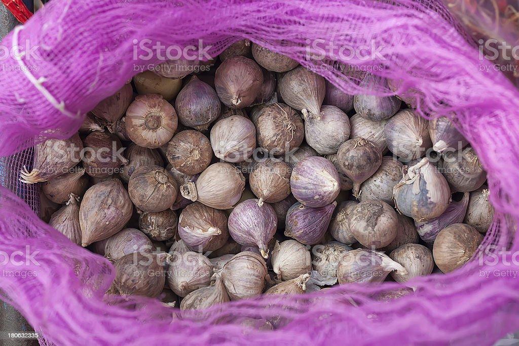 Single clove garlic in net bag royalty-free stock photo