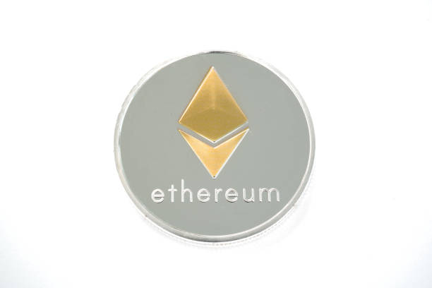 Single Coin of Silver Ethereum isolated on white background stock photo