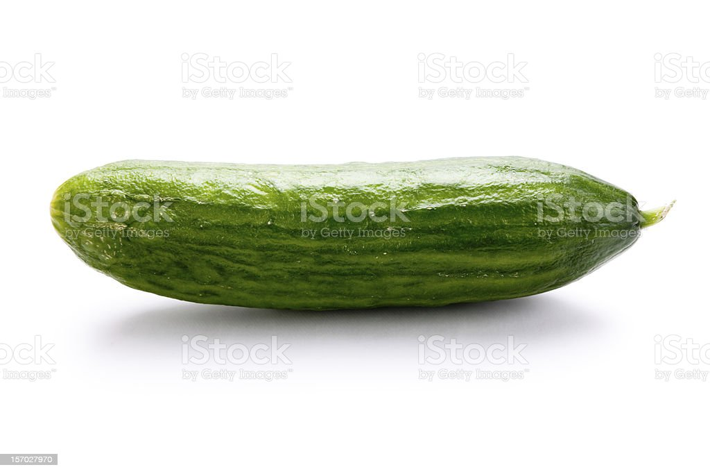Single cucumber against white background royalty-free stock photo