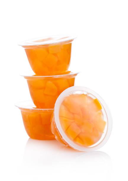 coupes simples avec peach en gelée de fruits - tasse photos et images de collection