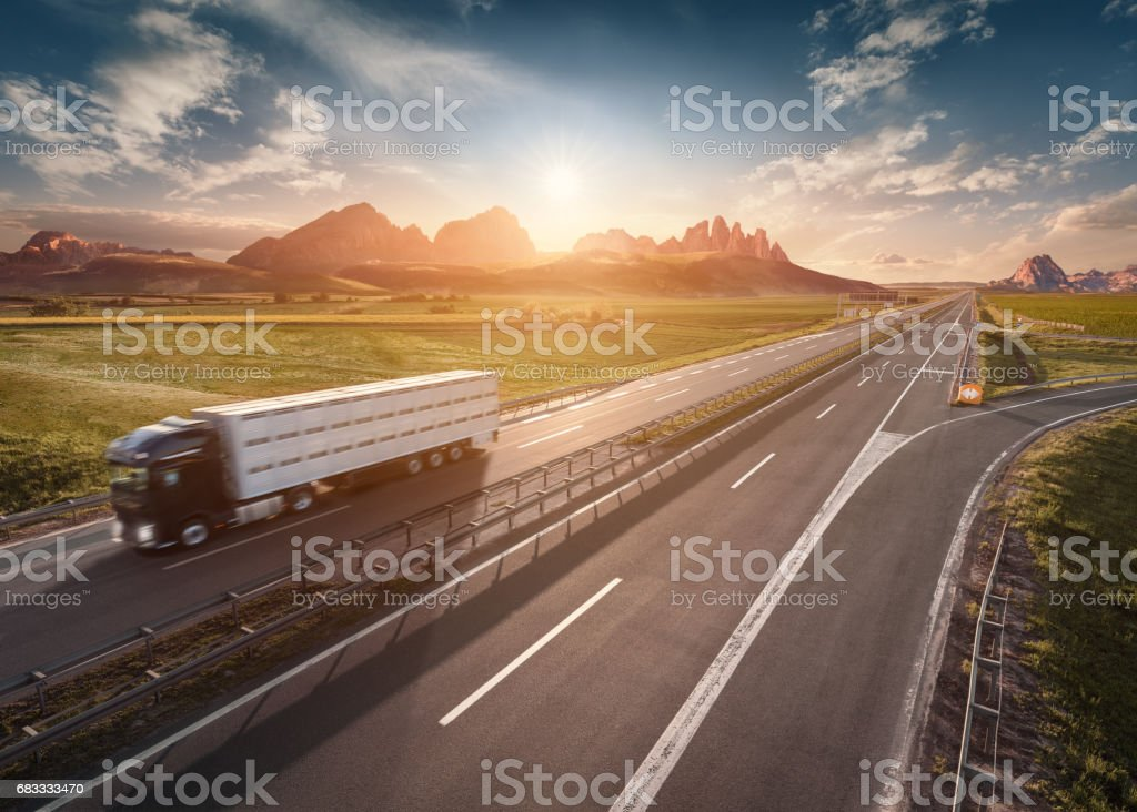 Single delivery truck on highway at idyllic morning royalty-free stock photo