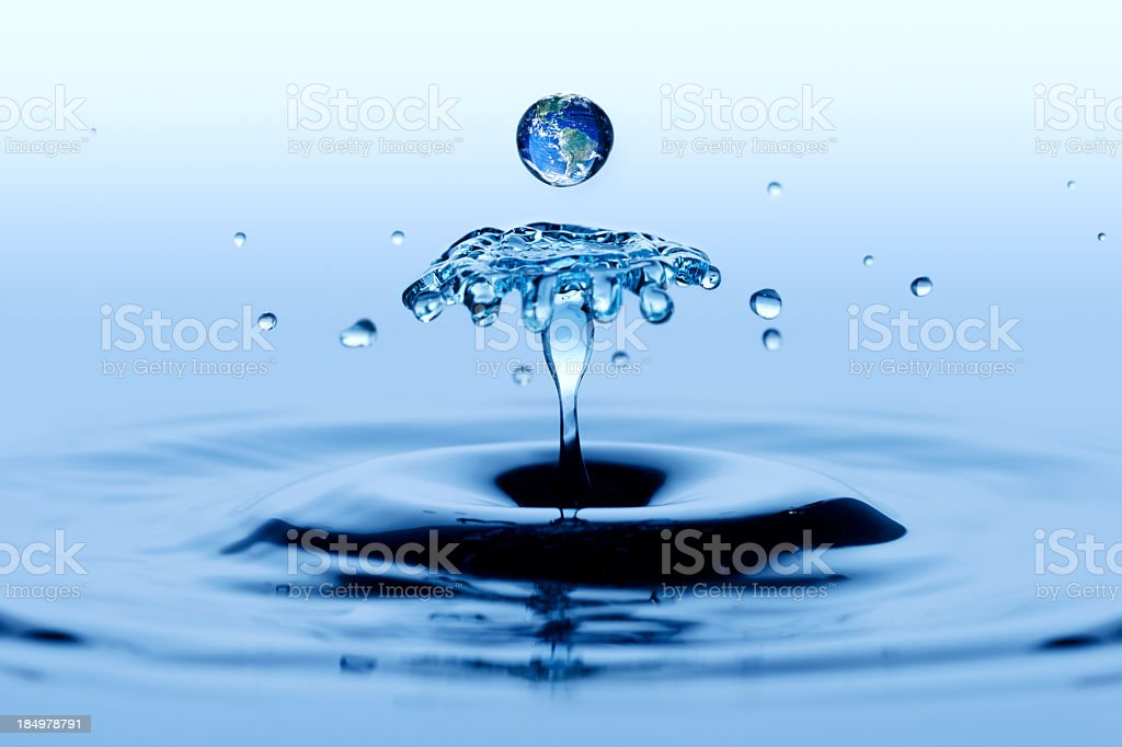 Single drop of water creating a slowed-down splash royalty-free stock photo